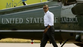 U.S.  President Barack Obama walks from Marine One upon his arrival in Martha's Vineyard in Massachusetts